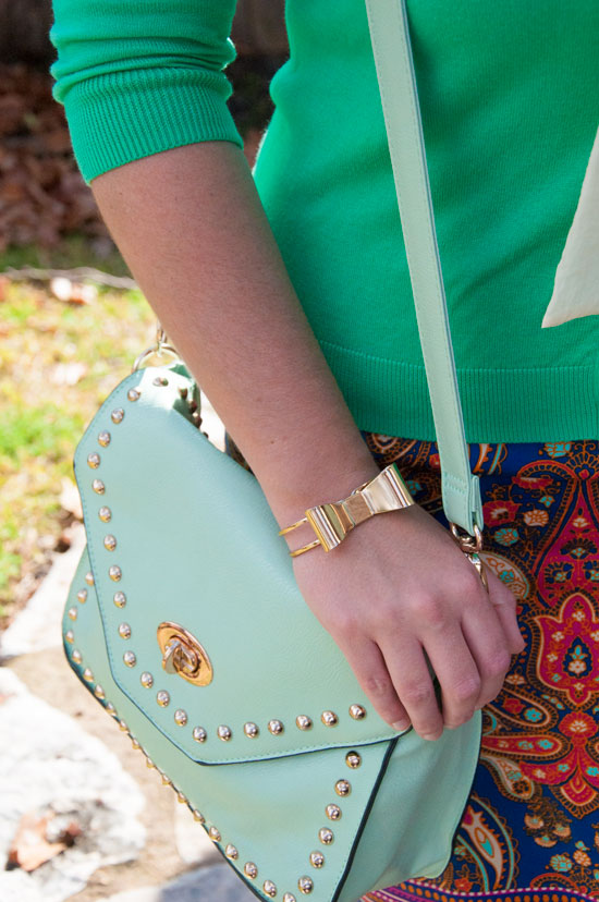 Mint handbag with gold rivet trim
