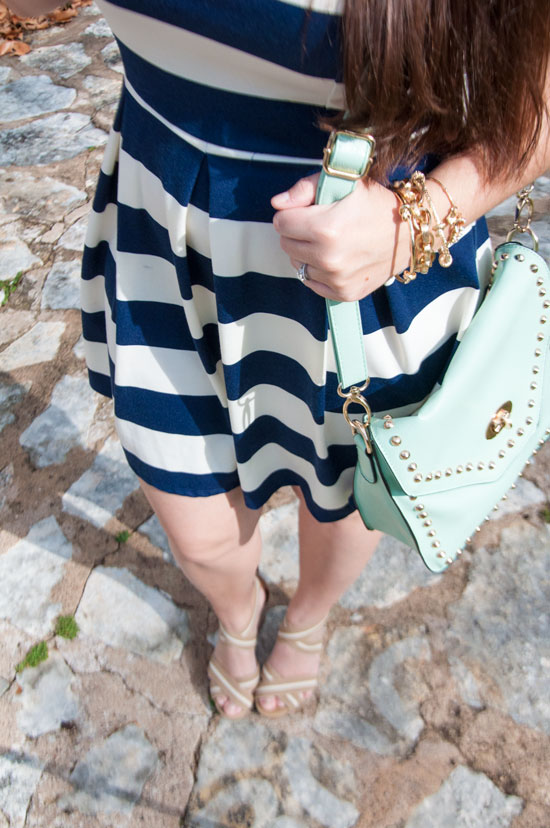 Nautical striped dress with mint handbag and gold jewelry