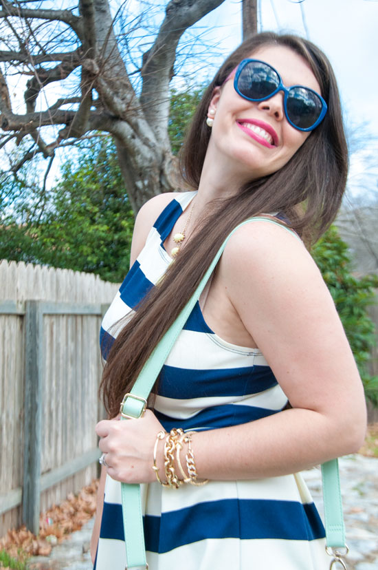 Navy and white dress with mint handbag