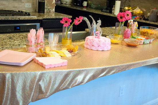 Pink and gold unicorn party- gold glitter vases, glitter unicorn cake, gold mason jars