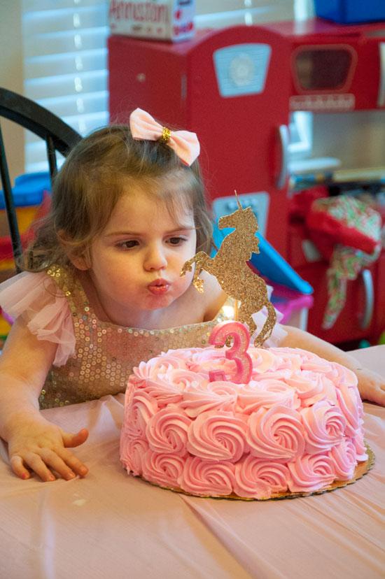 Unicorn birthday party cake- pink cake with gold glitter unicorn on top- DIY gold unicorn topper