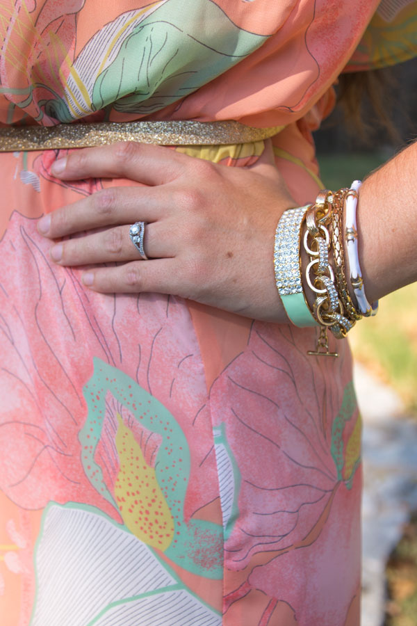 Peach and mint dress with gold accessories