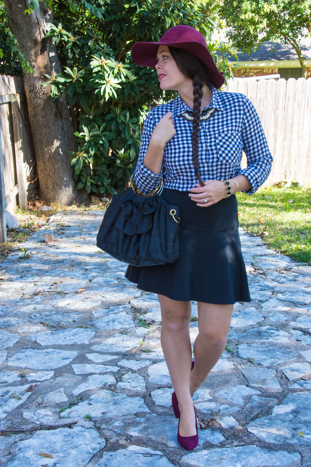 Gingham top with black skirt and hat